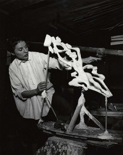 Gwen Lux, American sculptor and designer, 1908-1986, in her studio