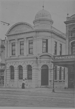 Looking north, showing the premises of F Prime (extreme right), J Martin, dentist, and the National Bank of New Zealand (centre), Record ID, 7-A4489, Auckland City Library